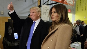 Republican presidential candidate Donald Trump, accompanied by his wife Melania, gives a thumbs-up after casting his ballot at PS-59, Tuesday, Nov. 8, 2016, in New York. (ANSA/AP Photo/ Evan Vucci) [CopyrightNotice: Copyright 2016 The Associated Press. All rights reserved.]